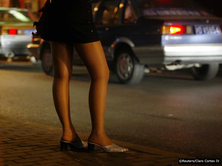 Young prostitute waits for clients on th