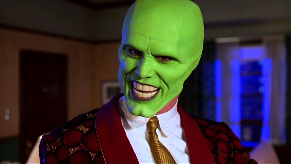Jim Carrey in The Mask (1994): an easy-going bank employee, turns into an eccentric green-skinned being