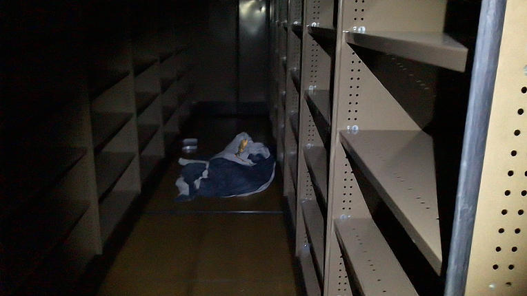 Alien Sleeping in the records room in th