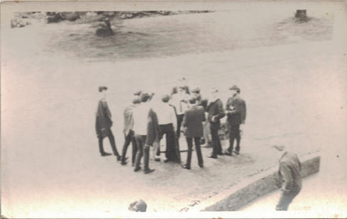 10 - A group of men have a chat in the f