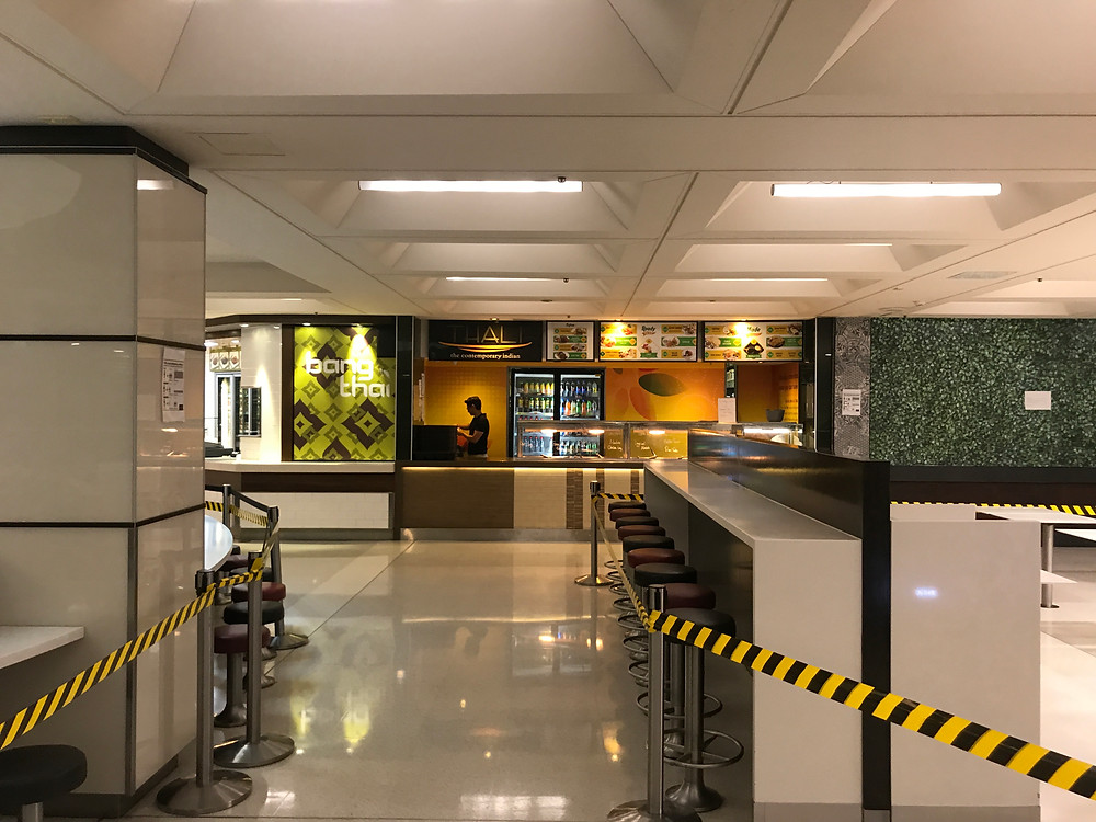 One of the few workers tends to an eatery outlet in the Carillon City Arcade food hall