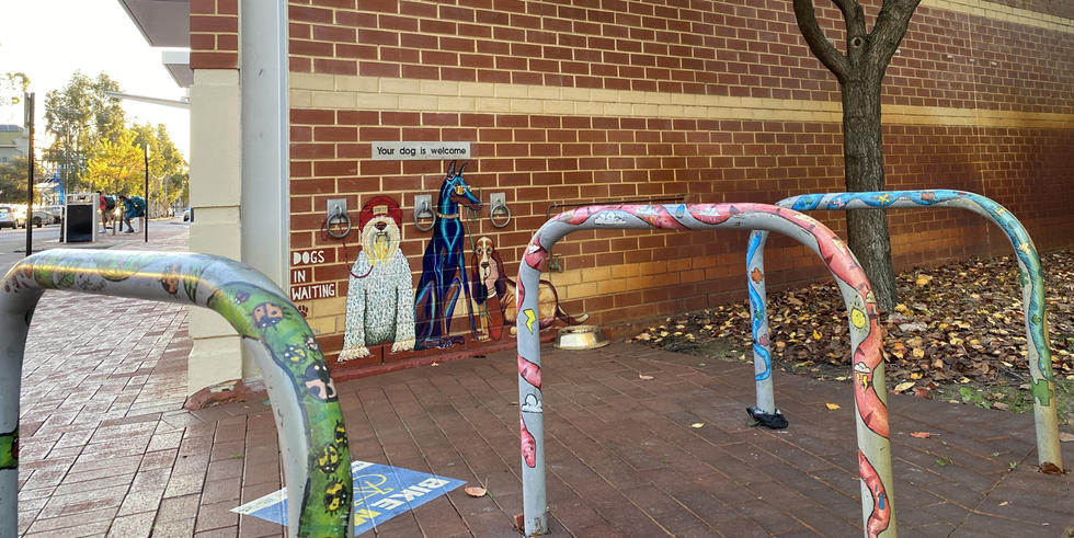 Murals and painted bike racks on the side wall of the Bassendean Public Library