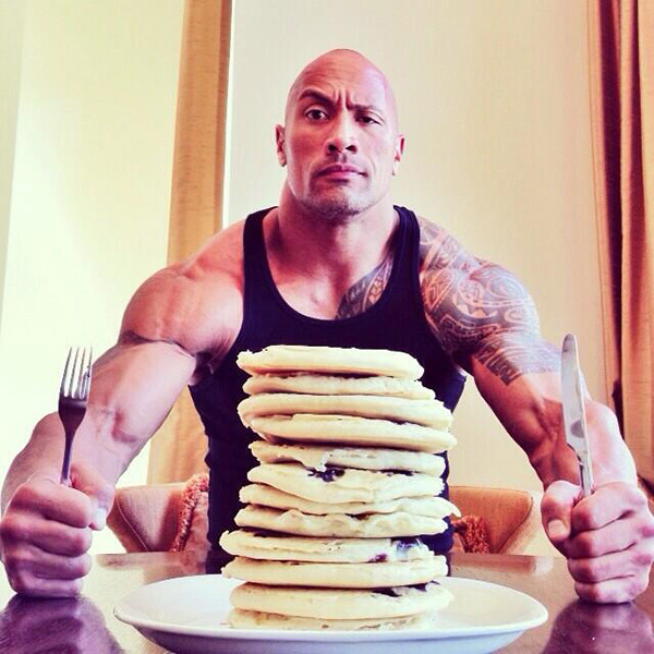 The Rock sitting down to eat some pancake carbohydrates. Protein is really important because you have to protect your muscles from breaking down