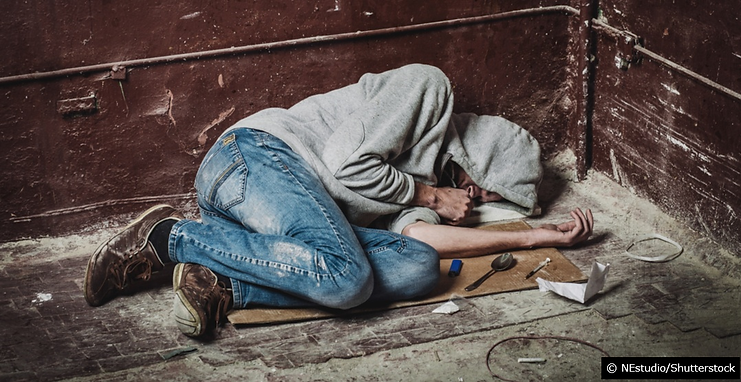 Homeless man unconscious passed out from