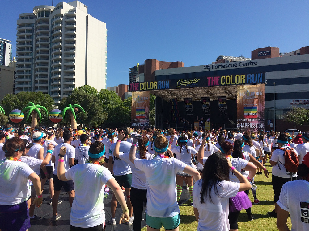 The Color Run 2016 held on The Esplanade in Perth, Western Australia - Color runner participants warm up at the main stage