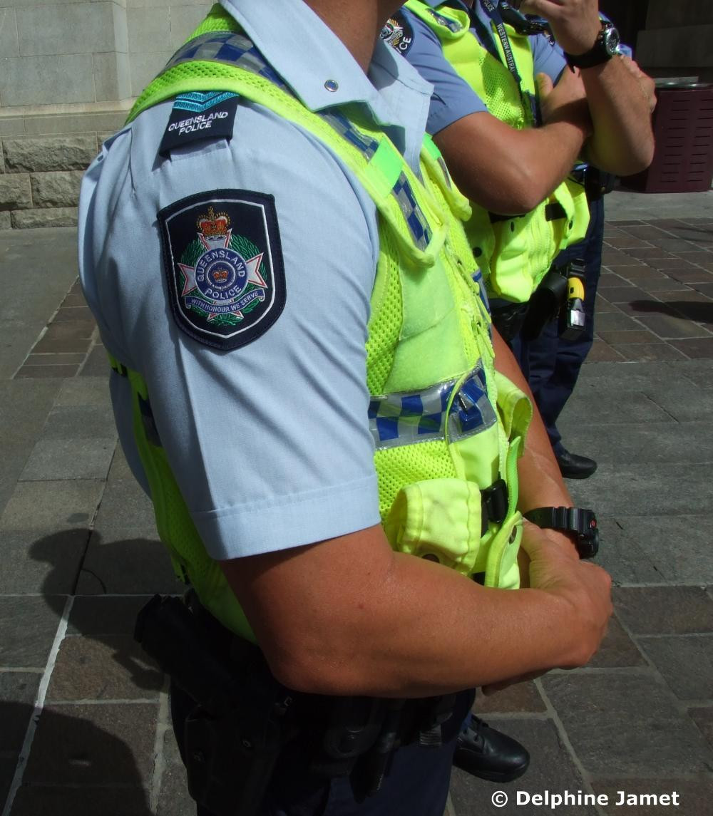 A Queensland police officer standing with a Western Australia officer in Forrest Chase for 2011 CHOGM Protests