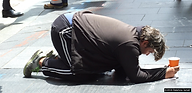 Homeless man begging on George Street in