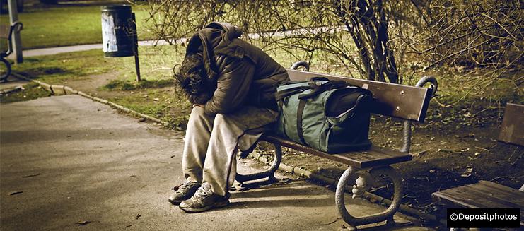 Homeless bench depressed sitting along o