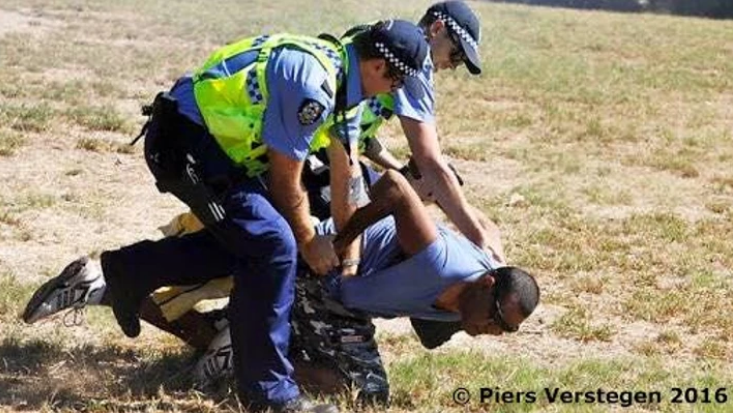 A man protesting arrested at Matagarup Refugee Camp Tent Embassy, Heirisson Island, Western Australia Police move on people who refuse to obey orders