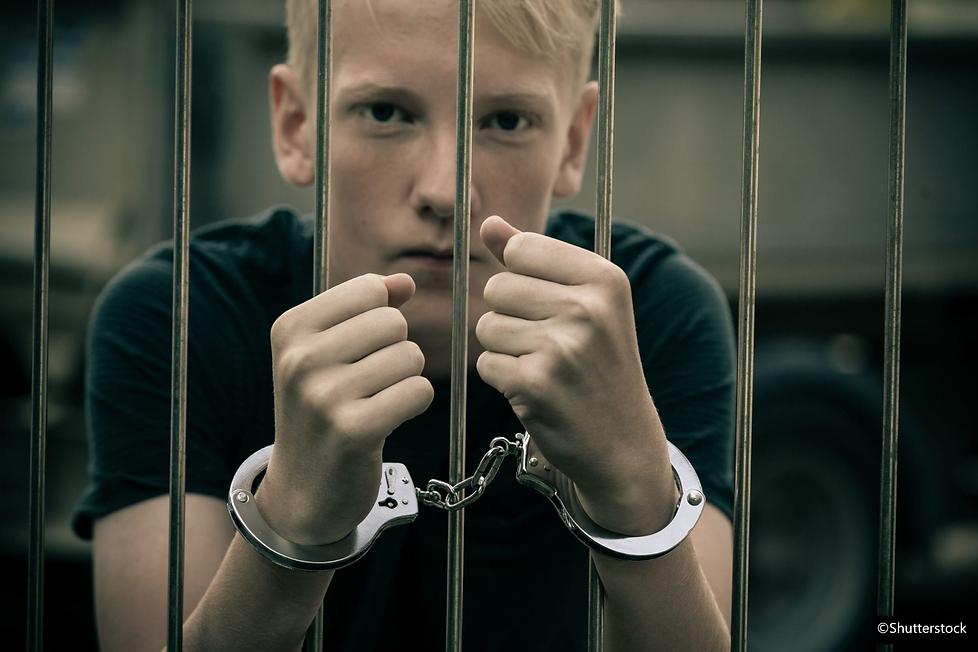 Juvenile boy arrested behind bars delinq