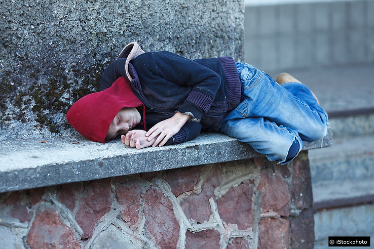 Homeless boy sleeping on the street no s