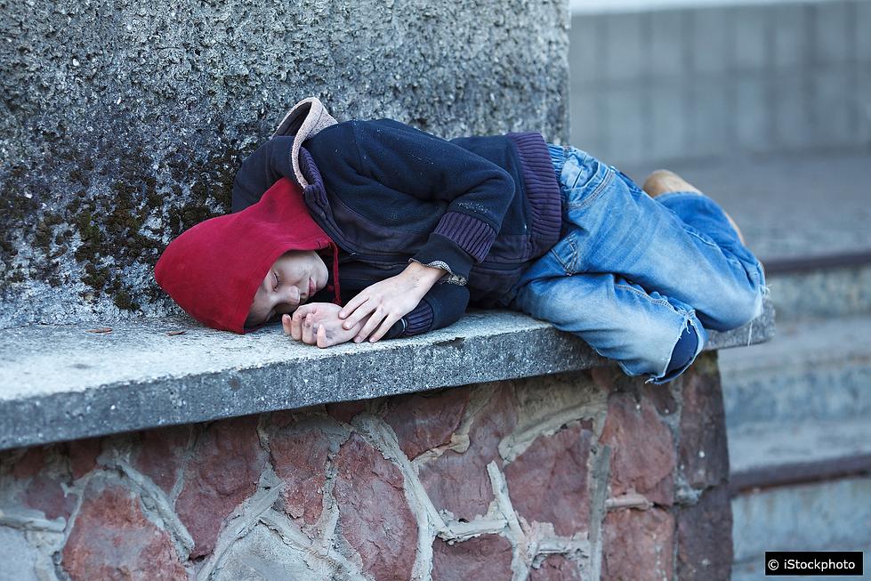 Homeless boy sleeping on the street no s