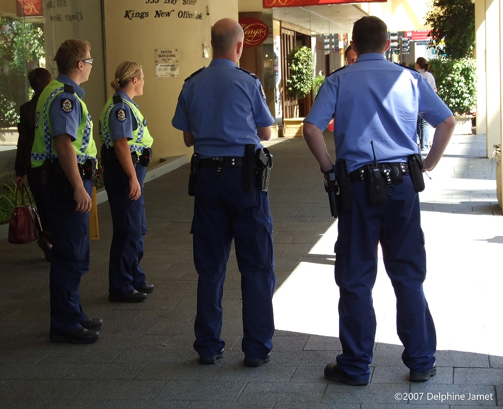 Western Australia Police confront a drug-affected lady outside the Kings Perth Hotel on Hay Street, in Western Australia