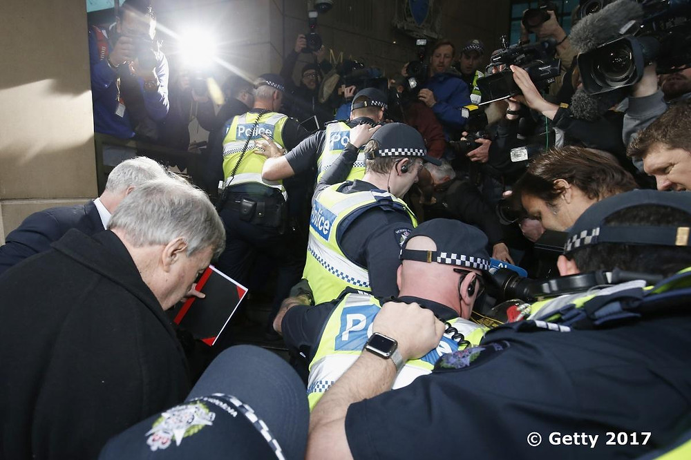 Cardinal George Pell attends The Melbourne Magistrate's Court to face historical child abuse charges whilst hordes of media capture it all