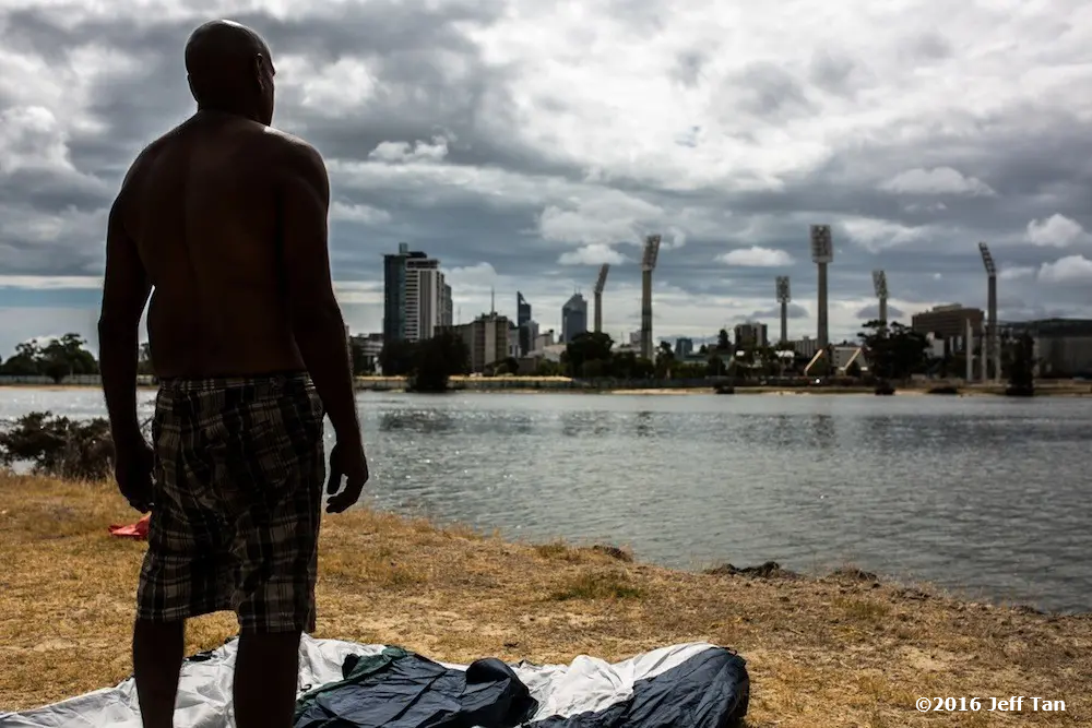 A Nyoongar man looks at East Perth from Matagarup Refugee Camp Tent Embassy, also known as Heirisson Island Aboriginal protestors shelter homeless