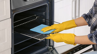 woman-cleaning-oven-in-kitchen-closeup-p