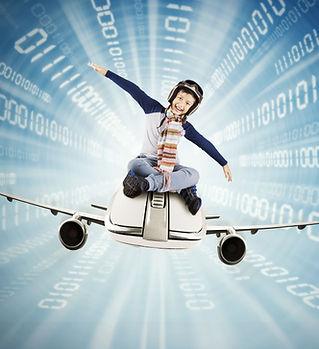 Little boy riding airplane inside a tunn