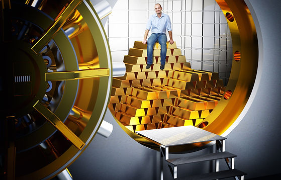 smiling man sit on pile of gold bars.jpg