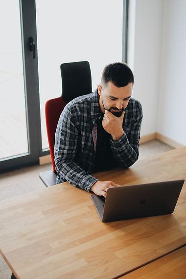man-using-laptop-computer-2102415.jpg