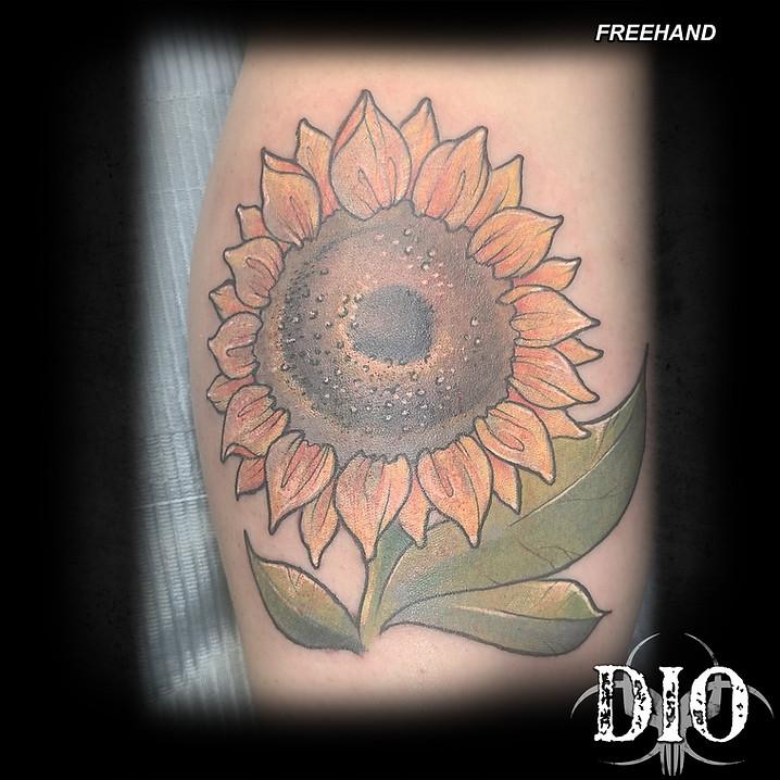 freehand sunflower on shin.jpg