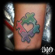 autism heart puzzle on dark skin.jpg