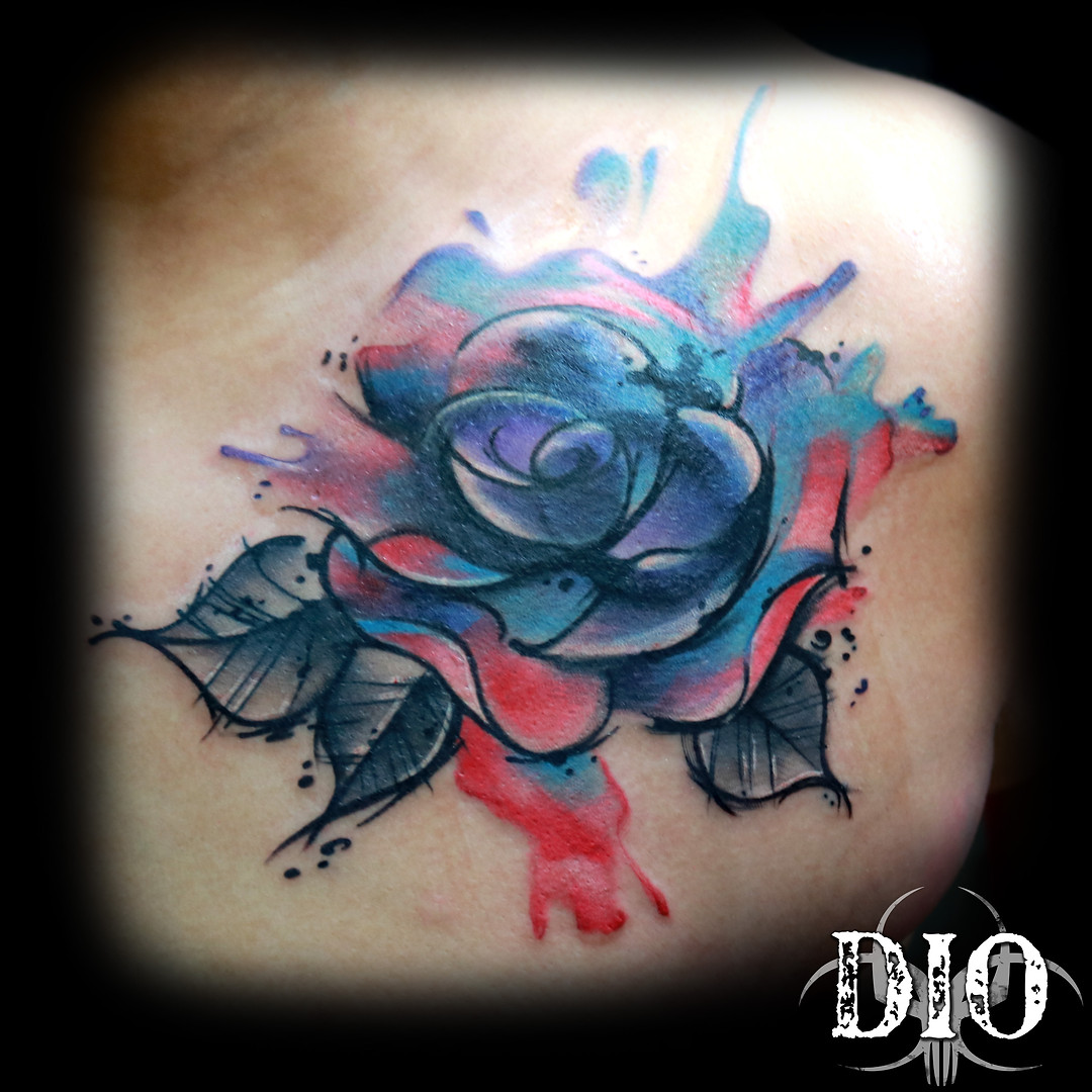 freehand watercolor rose on chest.jpg