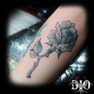 black & grey rose on forearm.jpg