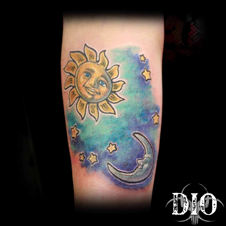 sun & moon on forearm