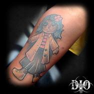 coraline doll on dark skin.jpg