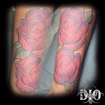 2 freehand roses on forearm.jpg