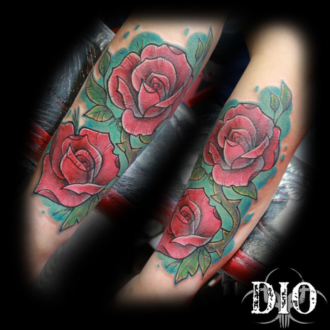 freehand roses on forearm.jpg