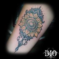 sunflower mandala paisley on forearm.jpg