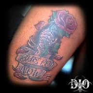 skeleton hand with rose & banner on dark