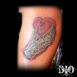 skeleton hand & heart on dark skin