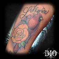 cardinal with yellow rose & script on da