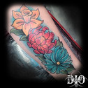 freehand full color flowers on forearm.j