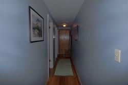 Hallway to 2 Bedrooms & Bath