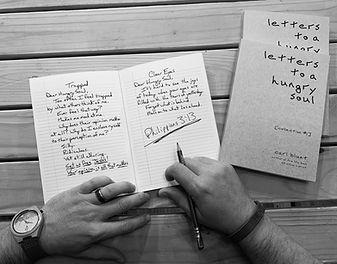 Carl hand and books.jpg