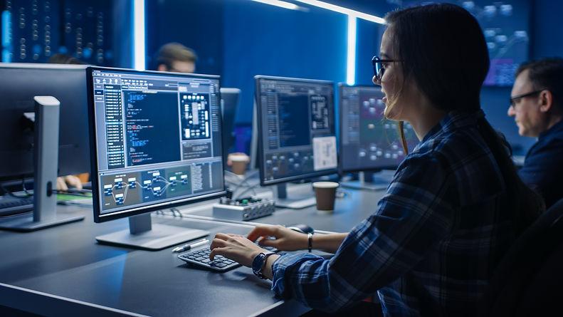 Smart Female IT Programer Working on Des