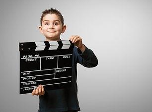 child-with-movie-clapboard_1187-1419.jpg