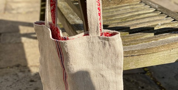 Grain sack tote with lining. Two handles.