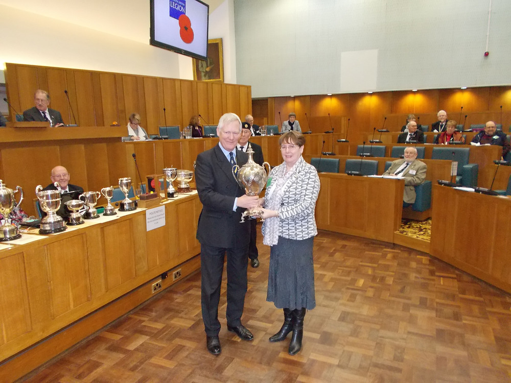 Helen receiving the Jex cup from the County President.