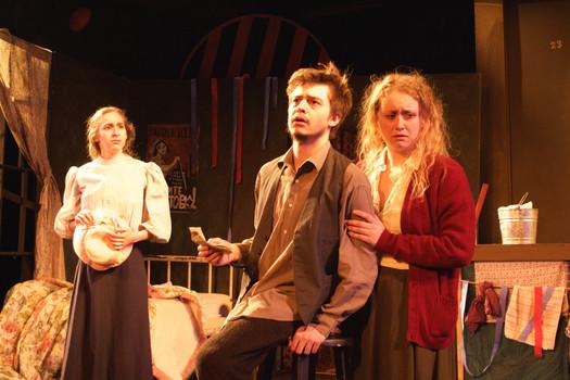 Semyon, Masha, and Serafima, react to the news of Yegor's suicide.