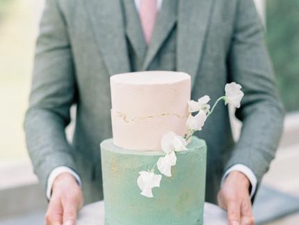 Glorious sage green and pink modern wedding cake
