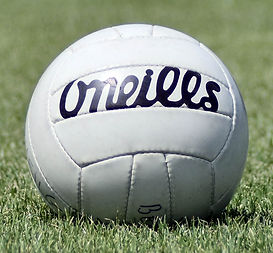 Gaelic_football_ball_on_pitch.jpg