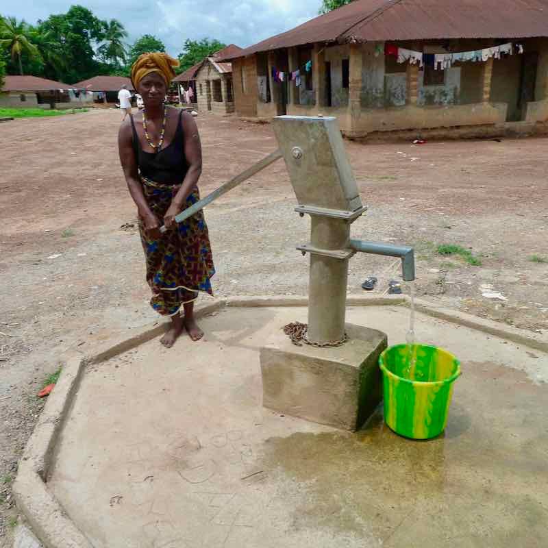 A village water pump in Sierra Leone built by Sunbird Bioenergy