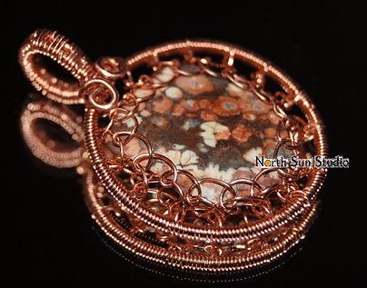 Copper wire-wrap pendant, net-weave setting, poppy jasper.