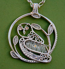 North Sun Studio jewellery, handmade wire-wrap sterling silver owl pendant with 14k gold eyes