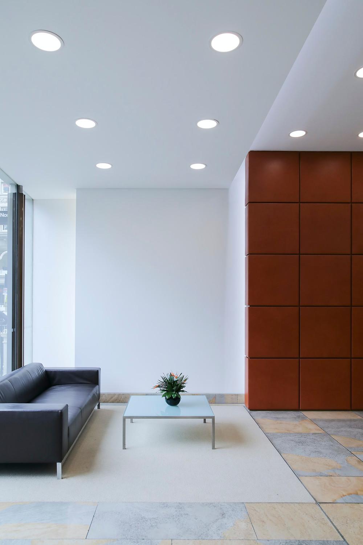 minimalist modern artist living room black leather sofa