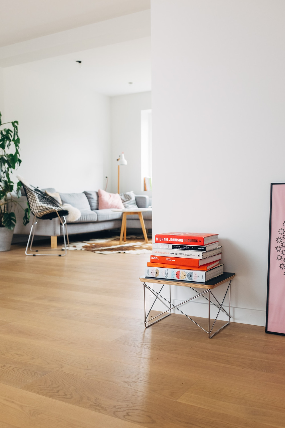 minimalist living room in white pink and light blue